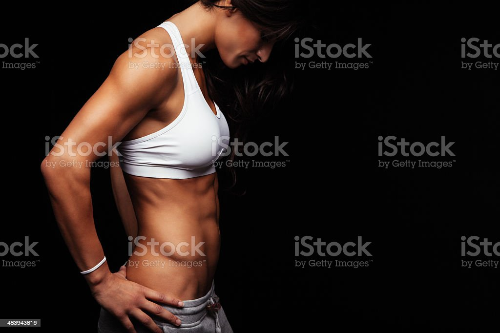 Young woman with muscular body stock photo