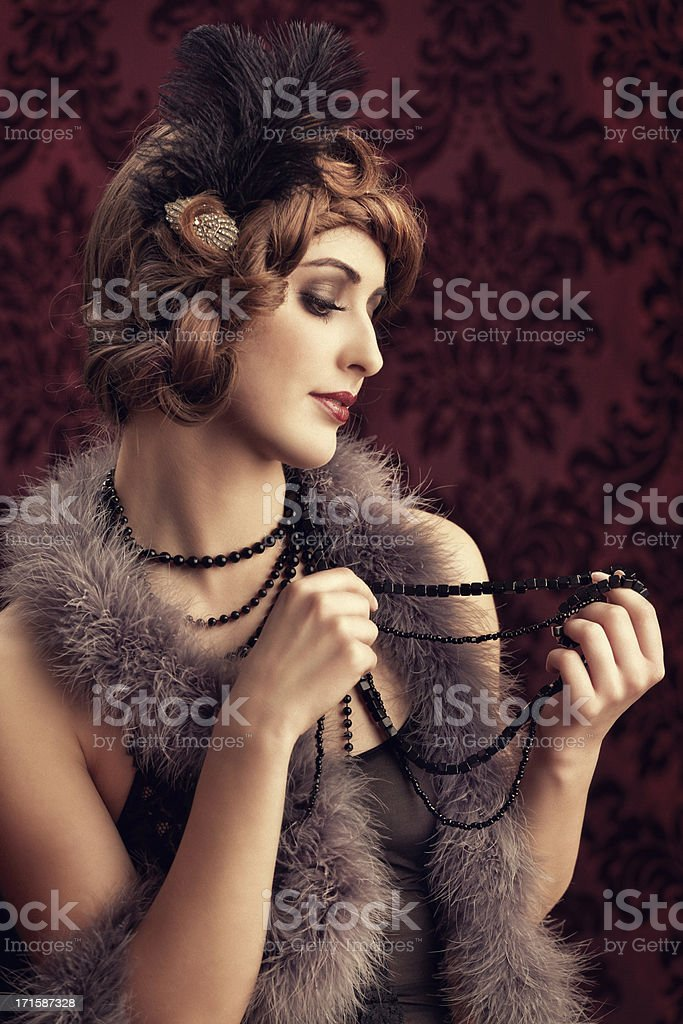 young woman with necklaces stock photo