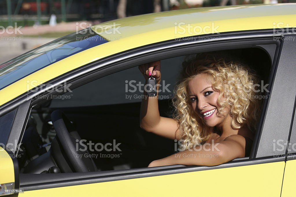 young woman with new car royalty-free stock photo