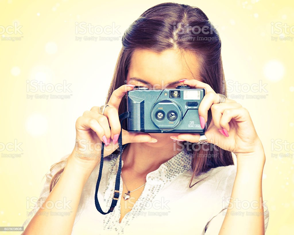 Young woman with old film camera stock photo
