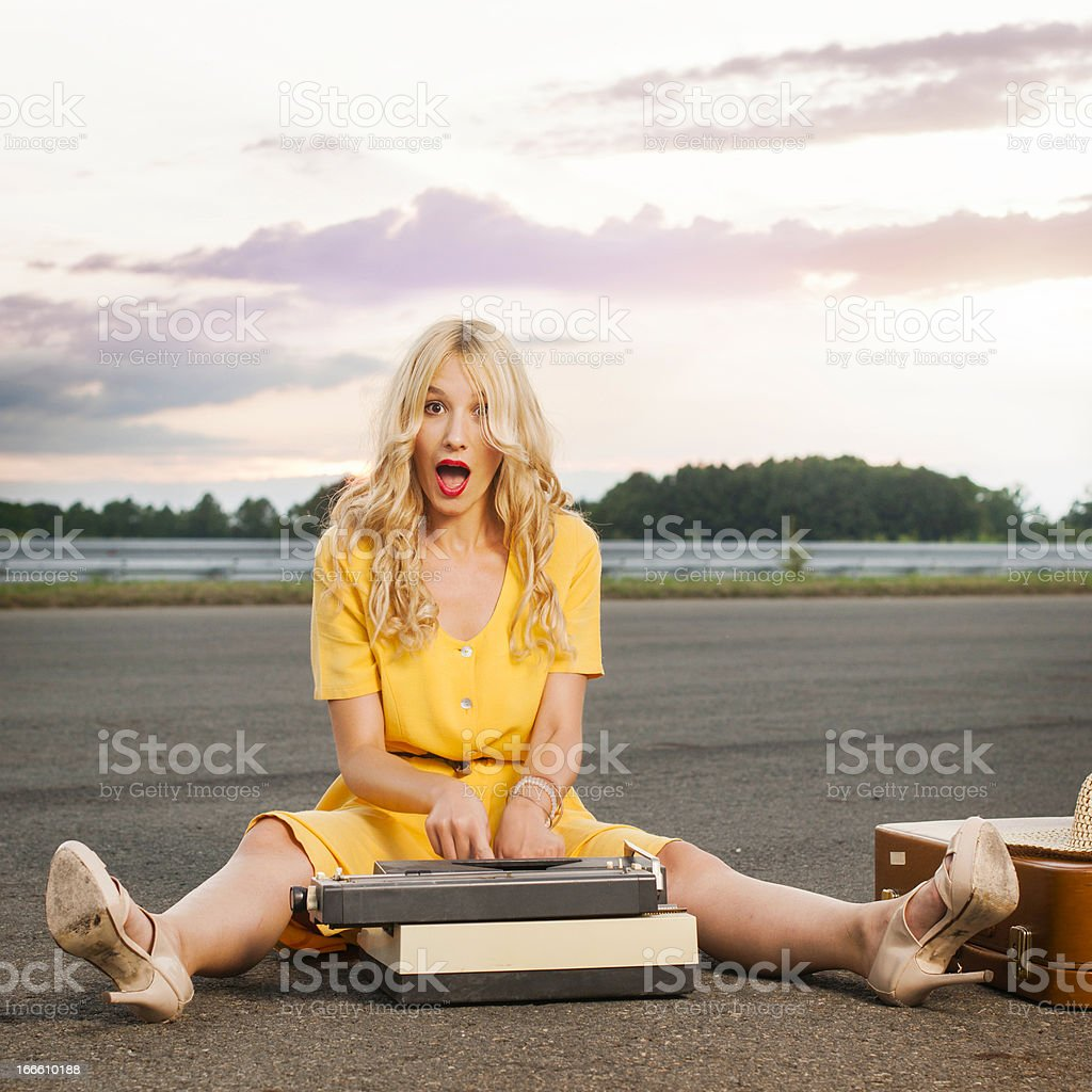 Young  woman with old typewriter royalty-free stock photo