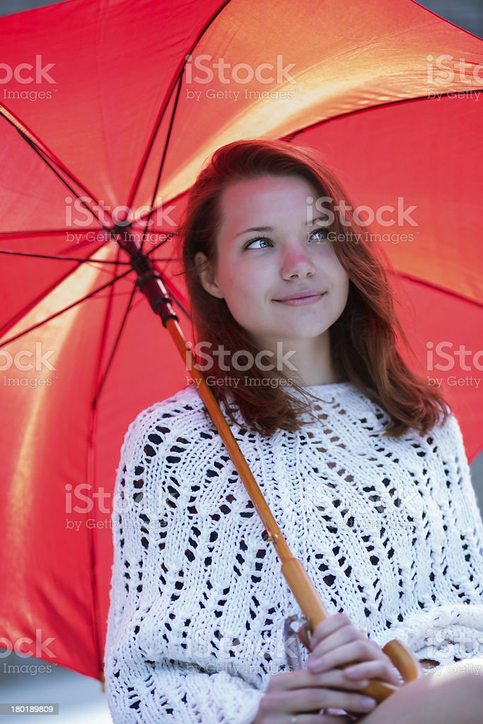 Young woman with open umbrella at hand royalty-free stock photo