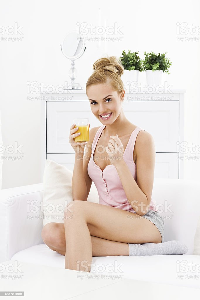 Young woman with orange juice royalty-free stock photo