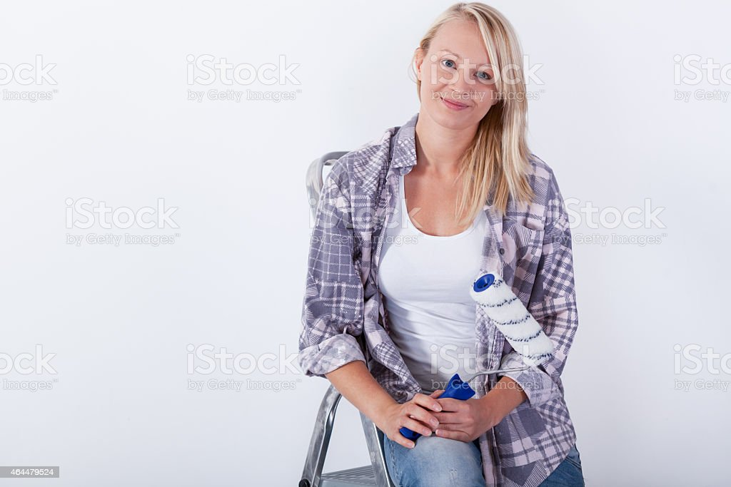 Young woman with paint roller stock photo