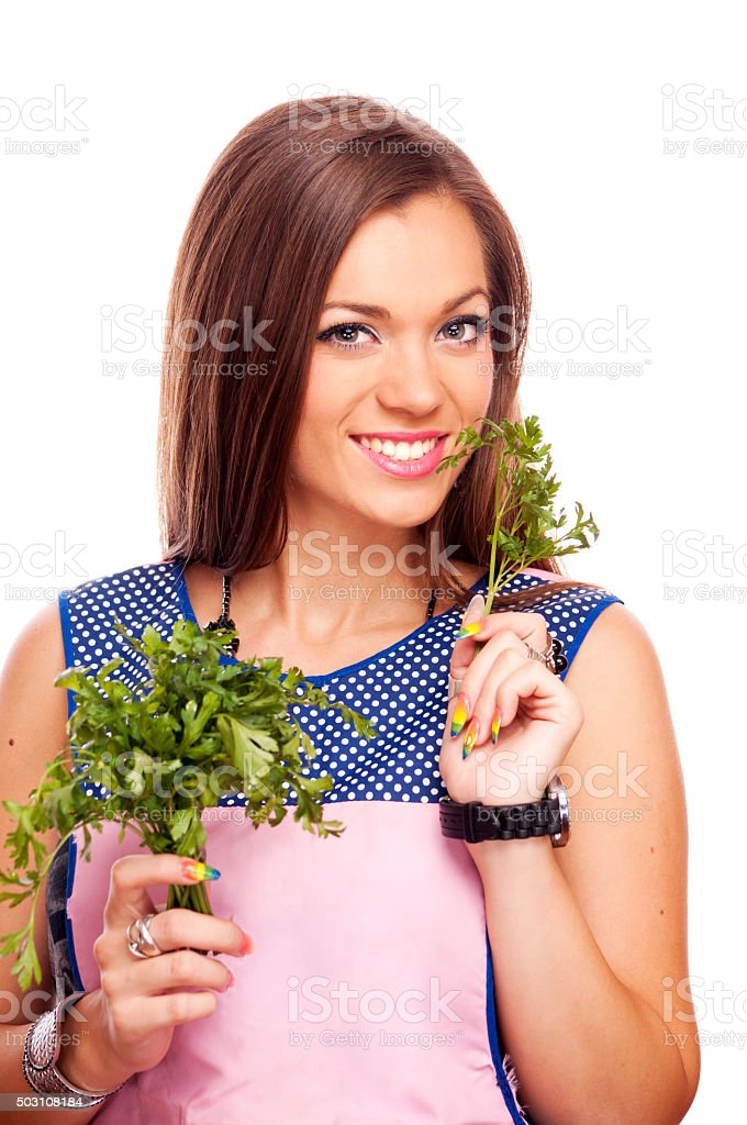 Young woman with parsley stock photo