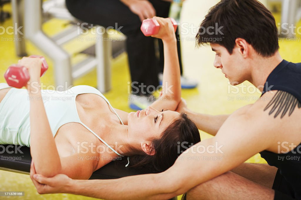 Young woman with personal trainer royalty-free stock photo
