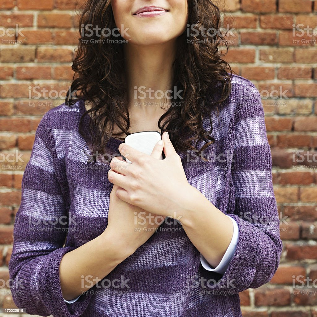 Young woman with phone smiling stock photo