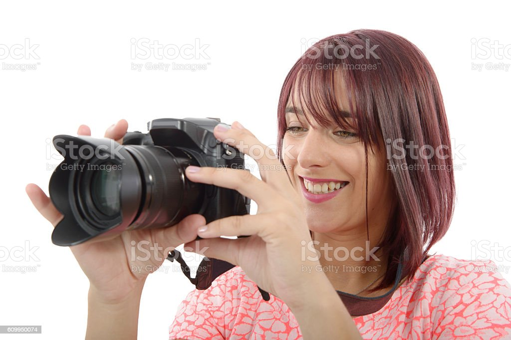 Young woman with photo camera.on white background stock photo