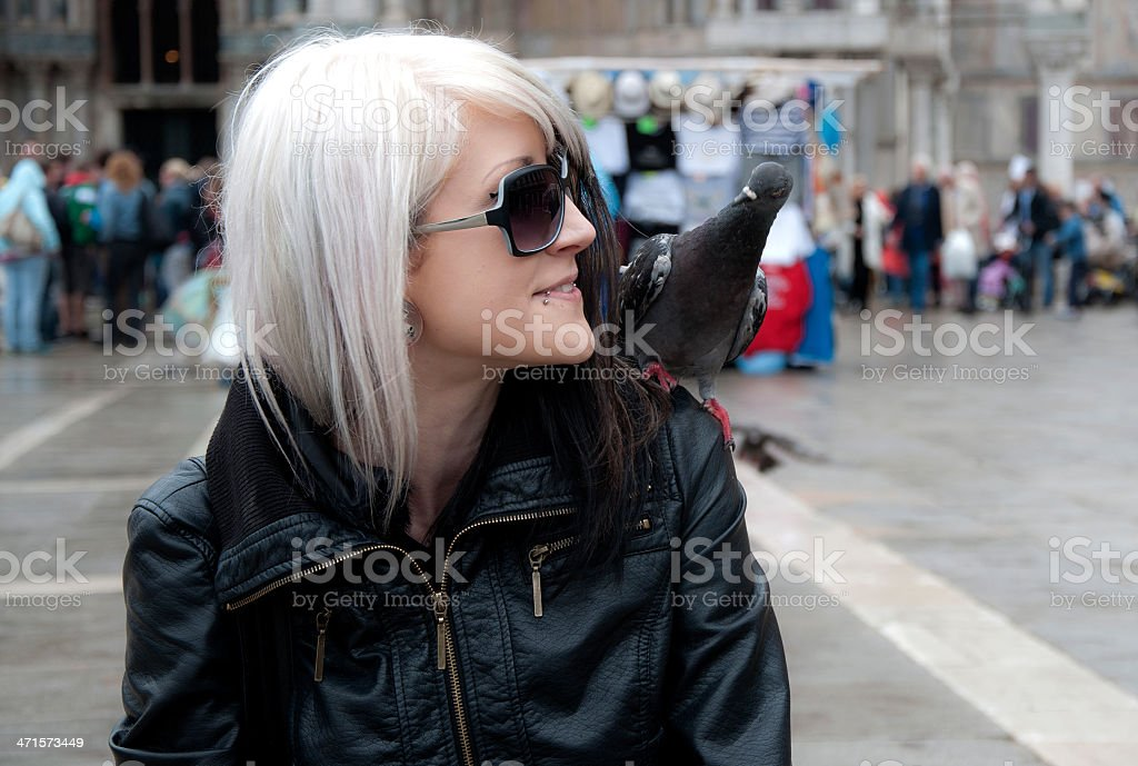 Young woman with pigeon stock photo