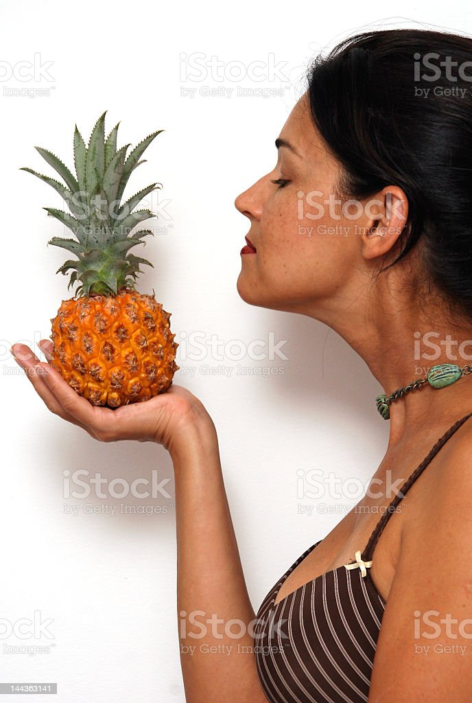 Young Woman with pineapple royalty-free stock photo