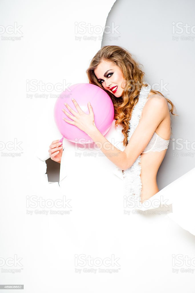 Young woman with pink ballooon stock photo