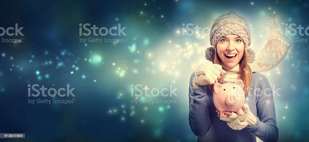 Young woman with pink piggy bank stock photo