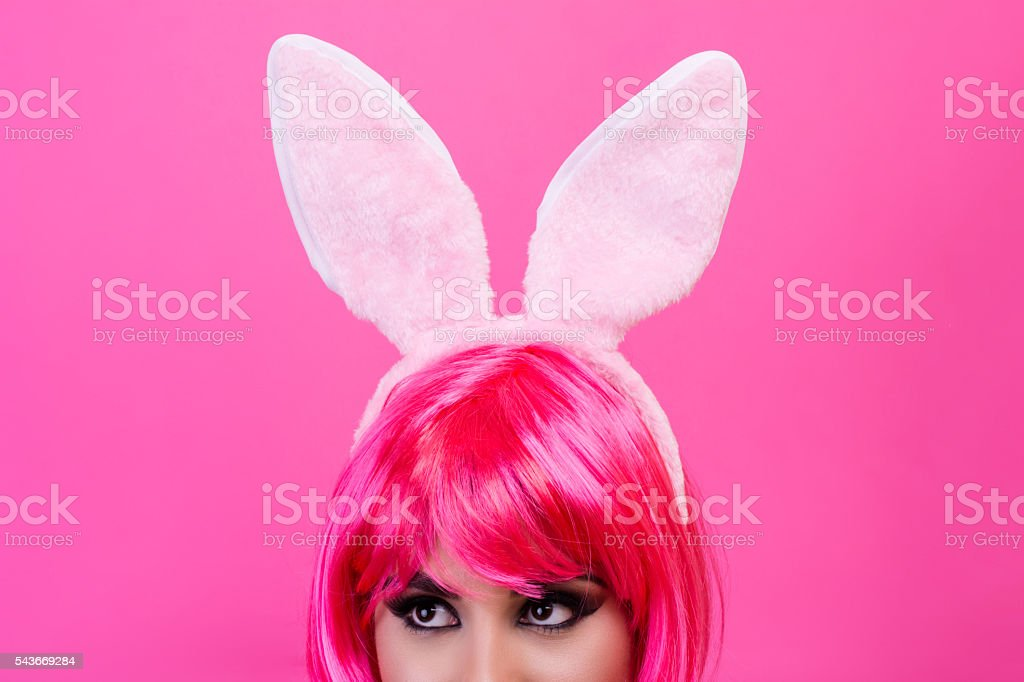 Young woman with pink wig and rabbit ears stock photo