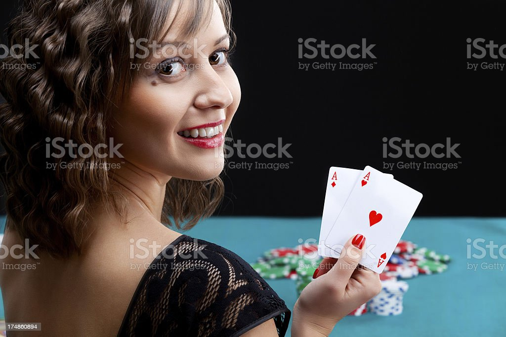 Young woman with poker cards royalty-free stock photo