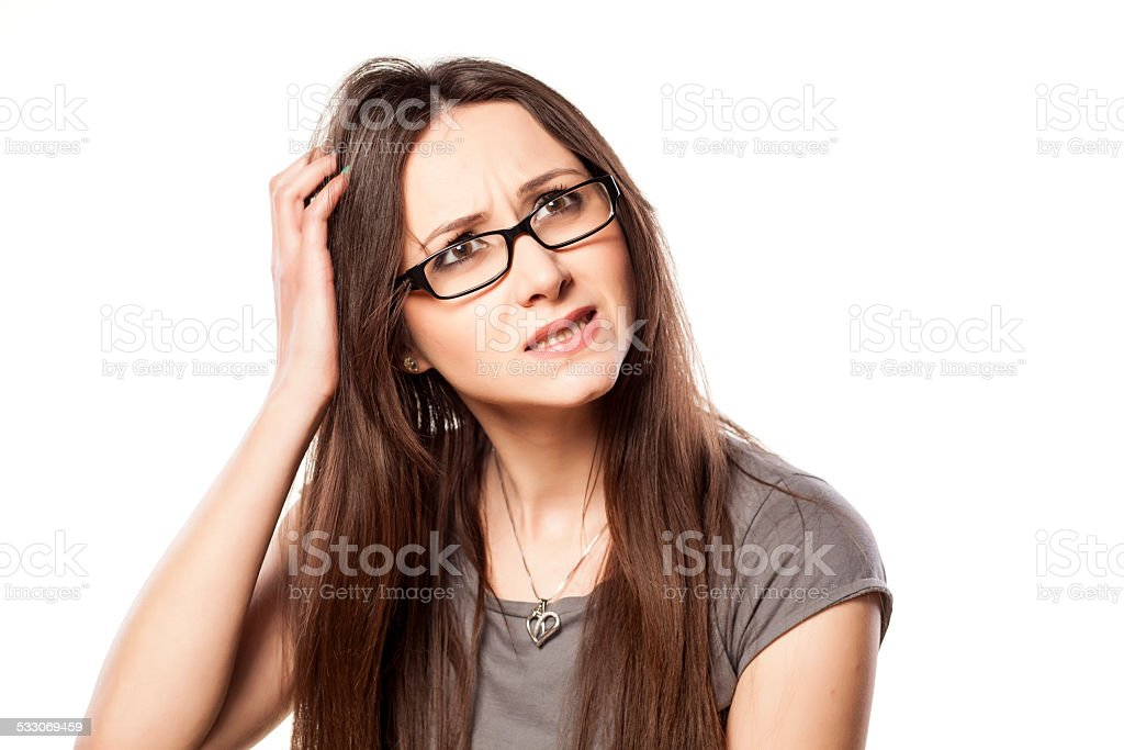 Young woman with questionable gesture scraping her hair stock photo