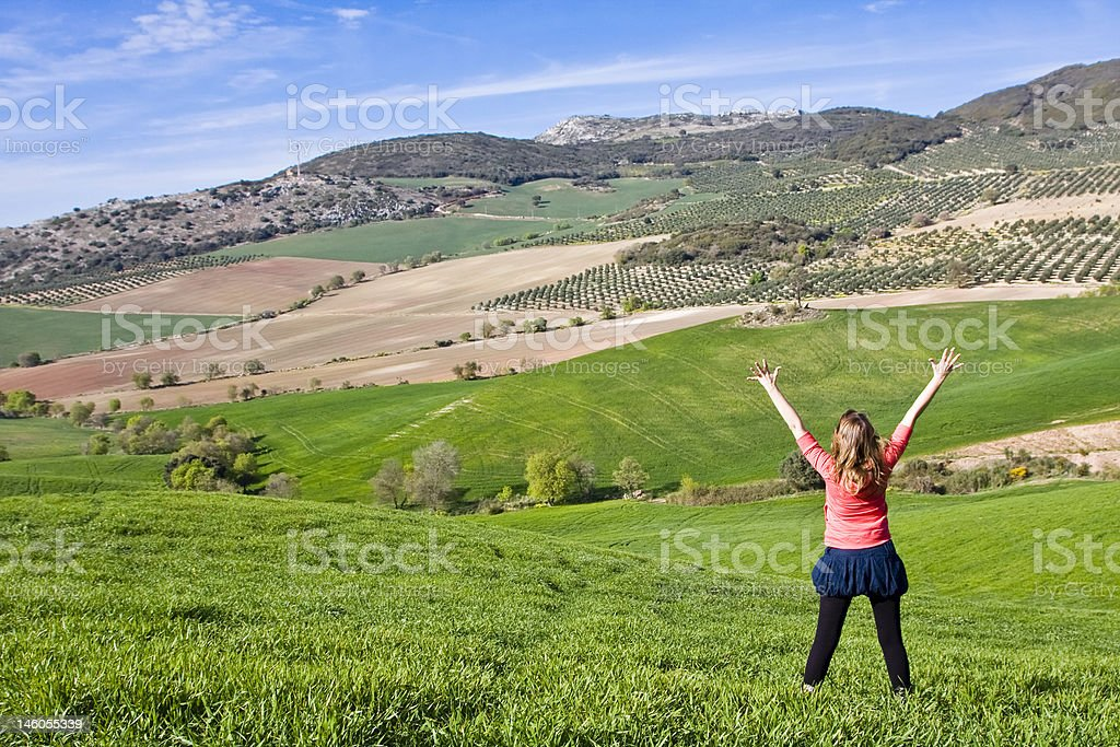 Young woman with raised arms royalty-free stock photo
