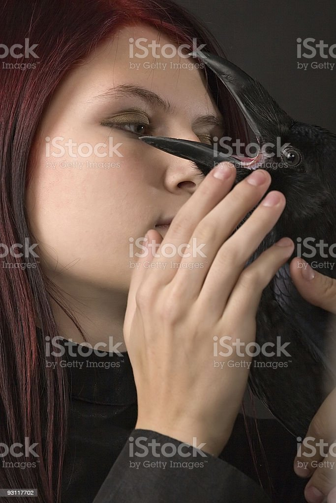 young woman with raven royalty-free stock photo