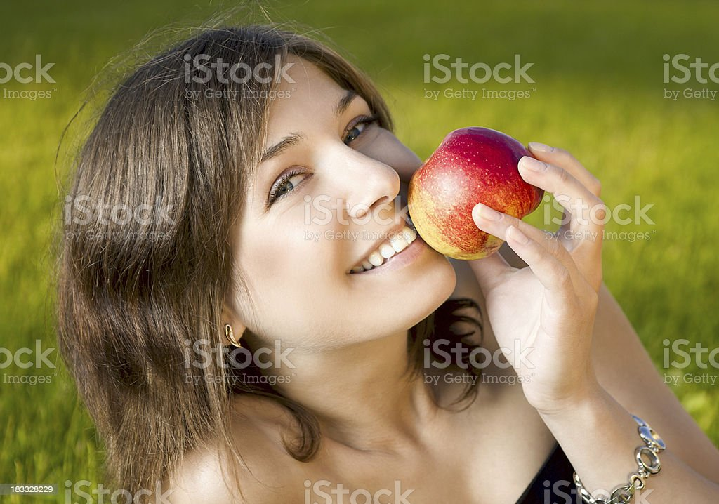 Young woman with red apple stock photo