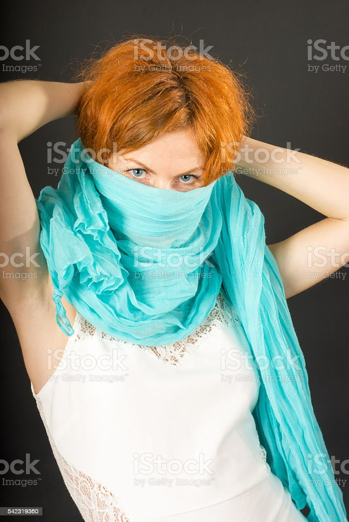 Young woman with red curly hair stock photo