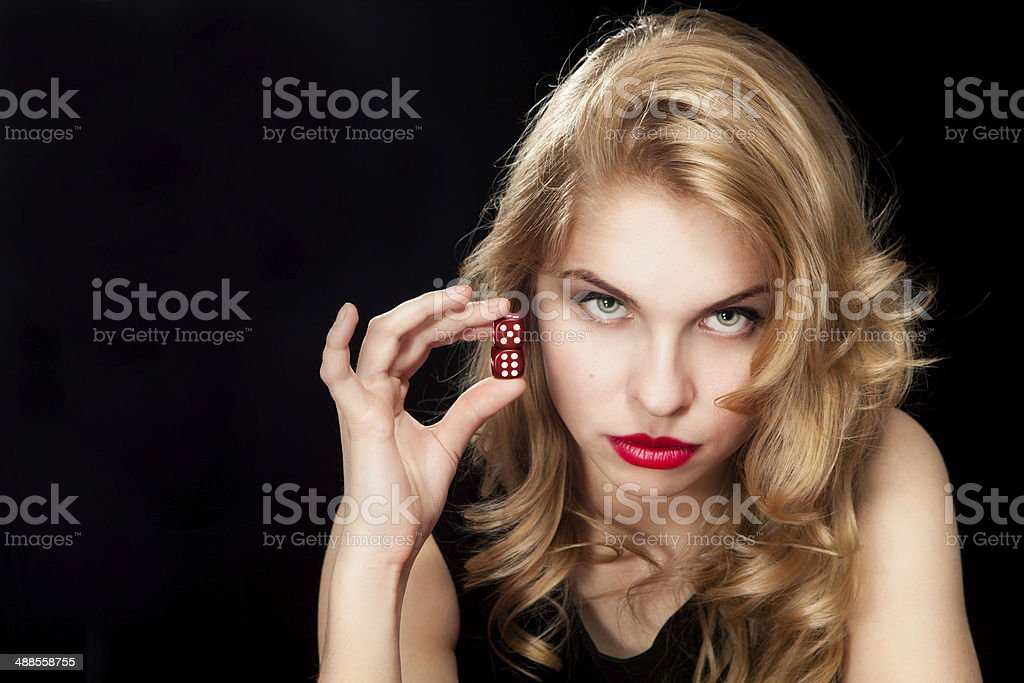 Young woman with red dice stock photo