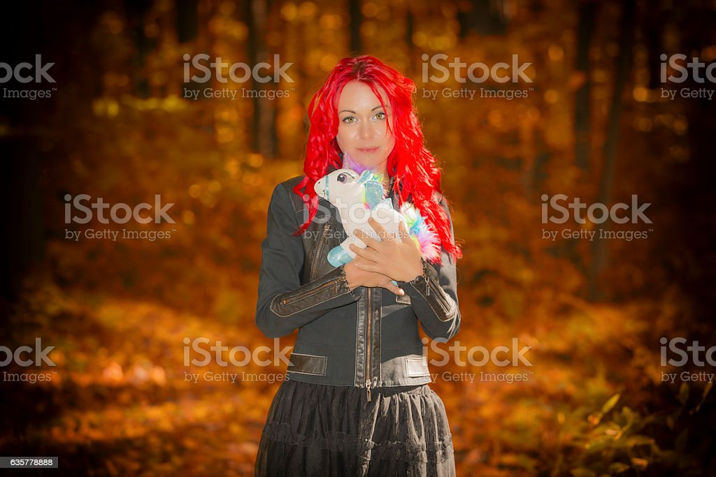 Young woman with red hair in forest stock photo