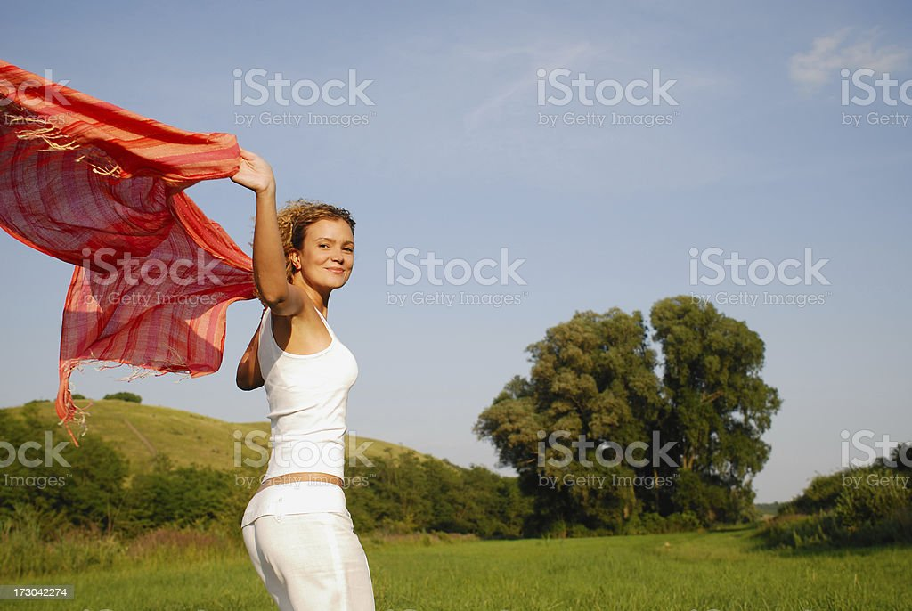 Young woman with red scarf stock photo