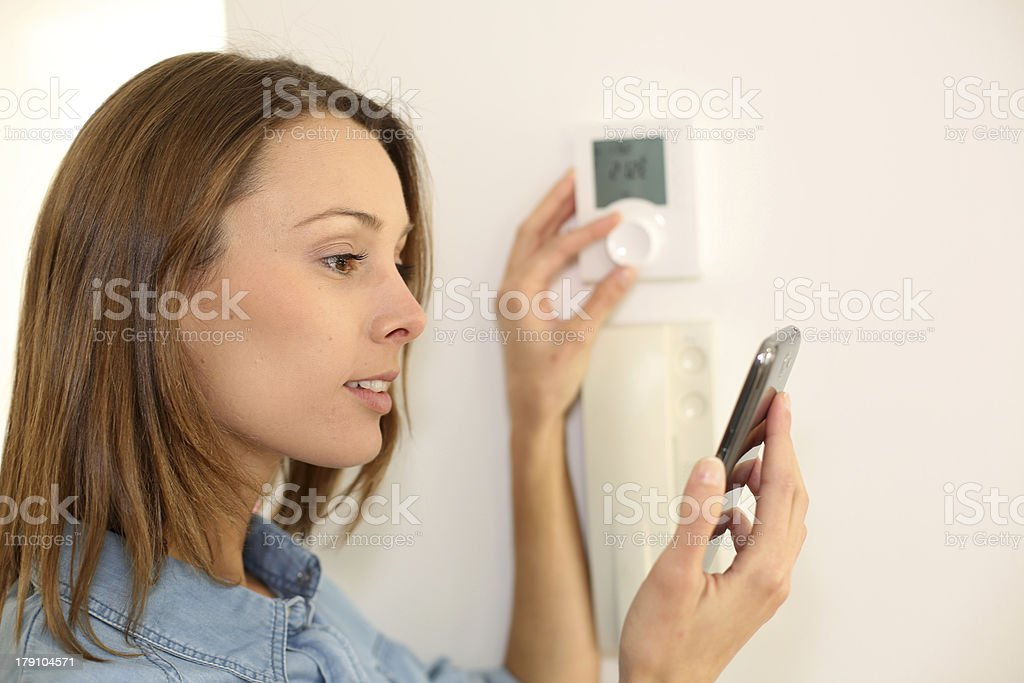Young woman with regulator temperature stock photo
