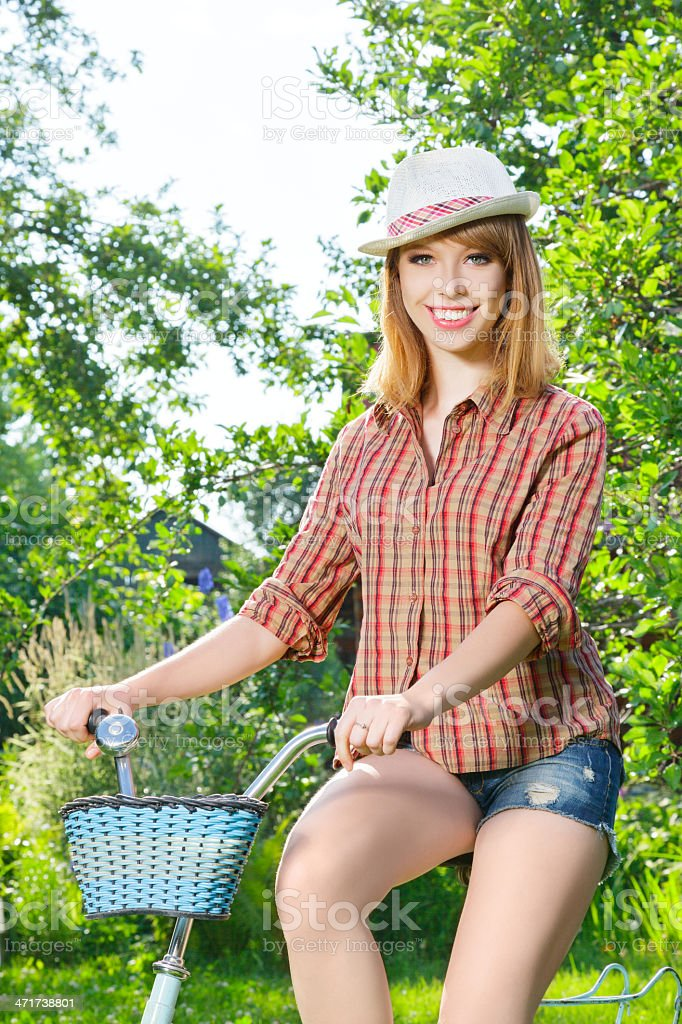 Young woman with retro bicycle in a park royalty-free stock photo