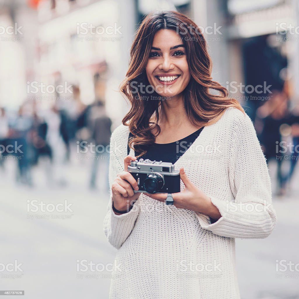 Young woman with retro camera outdoors stock photo