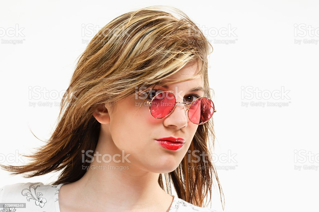 Young woman with rose tinted glasses stock photo