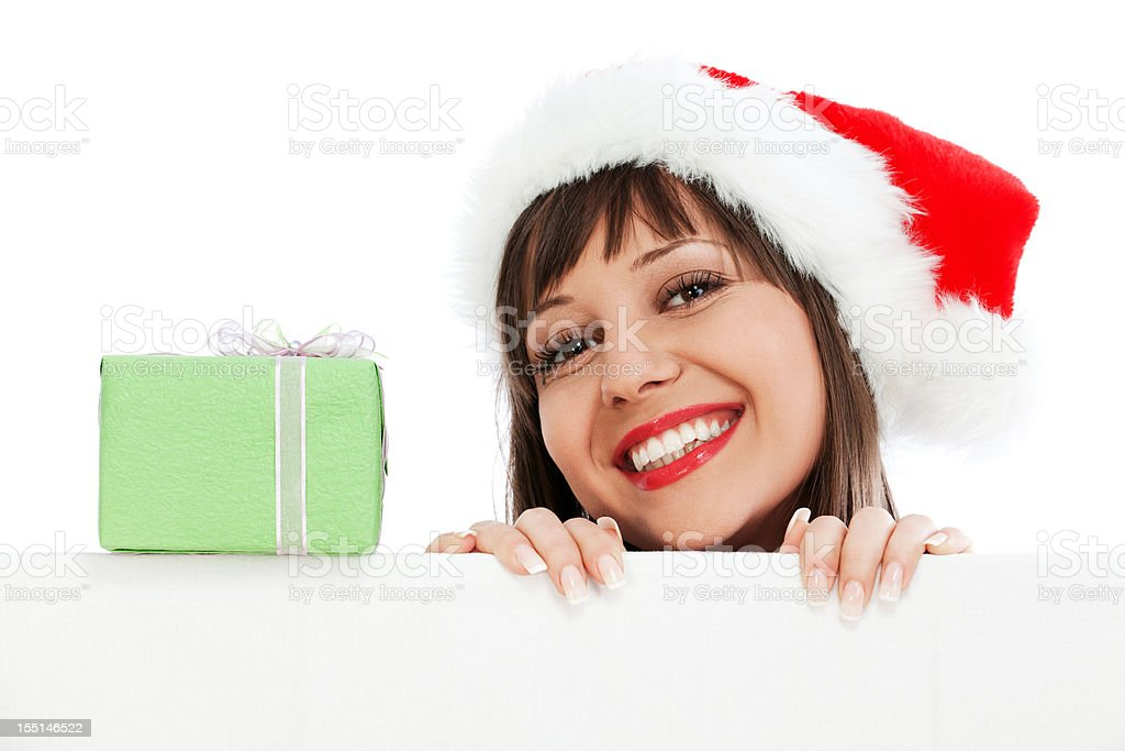 Young woman with santa hat and christmas gift stock photo
