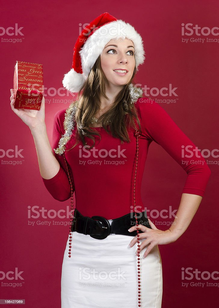 Young Woman with Santa Hat and Gift royalty-free stock photo