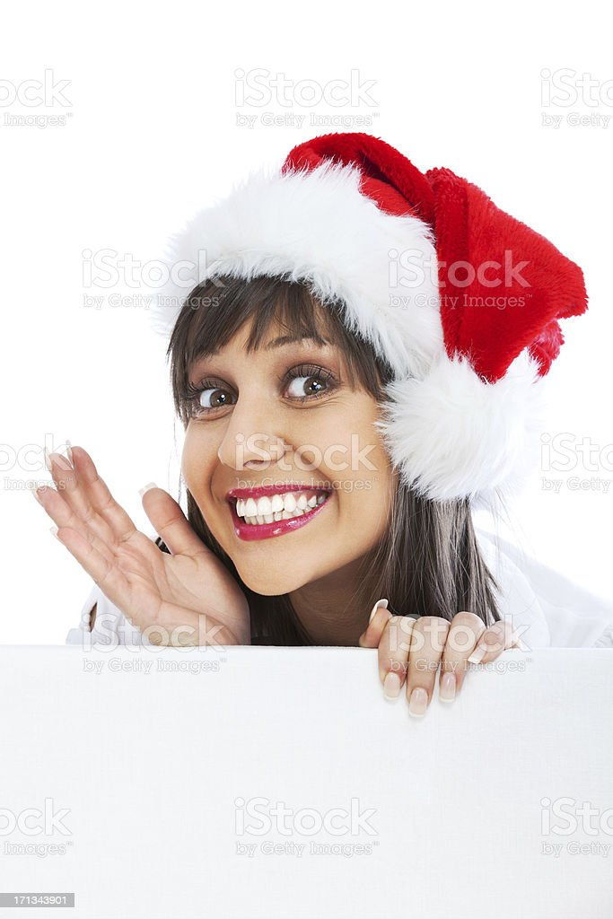 Young woman with santa hat whispering stock photo