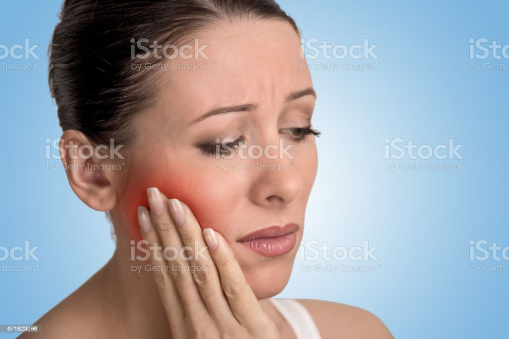 young woman with sensitive tooth ache crown problem about to cry from pain stock photo