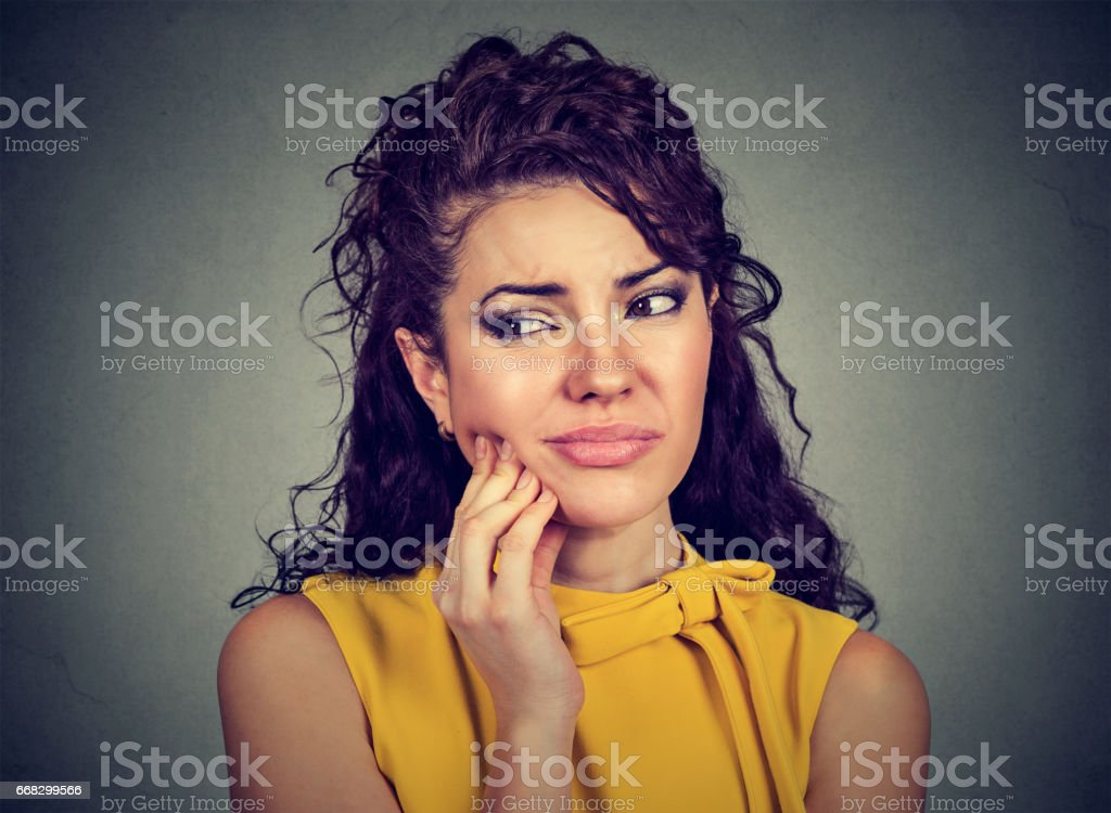 young woman with sensitive tooth ache stock photo