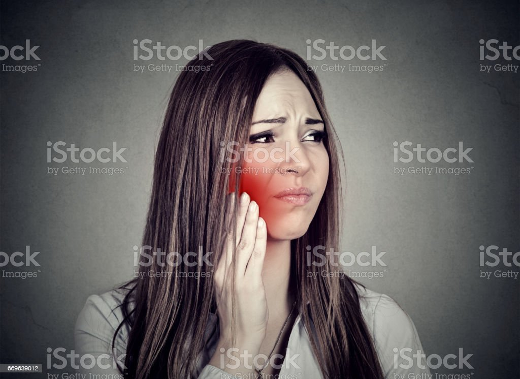 Young woman with sensitive toothache crown problem suffering from pain stock photo
