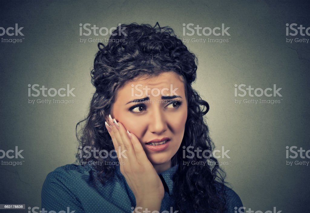 young woman with sensitive toothache stock photo
