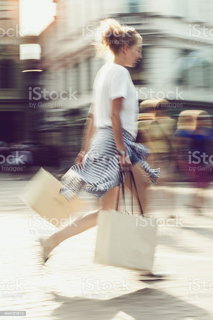 Young woman with shopping bags on the street stock photo