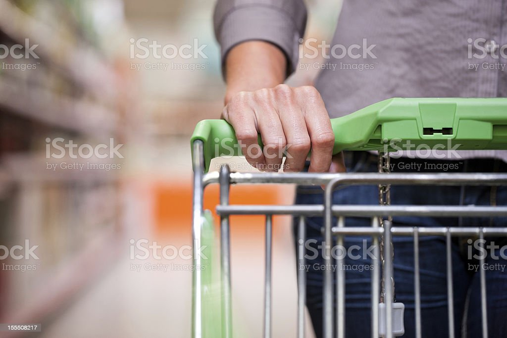 Young woman with shopping cart in supermarket stock photo