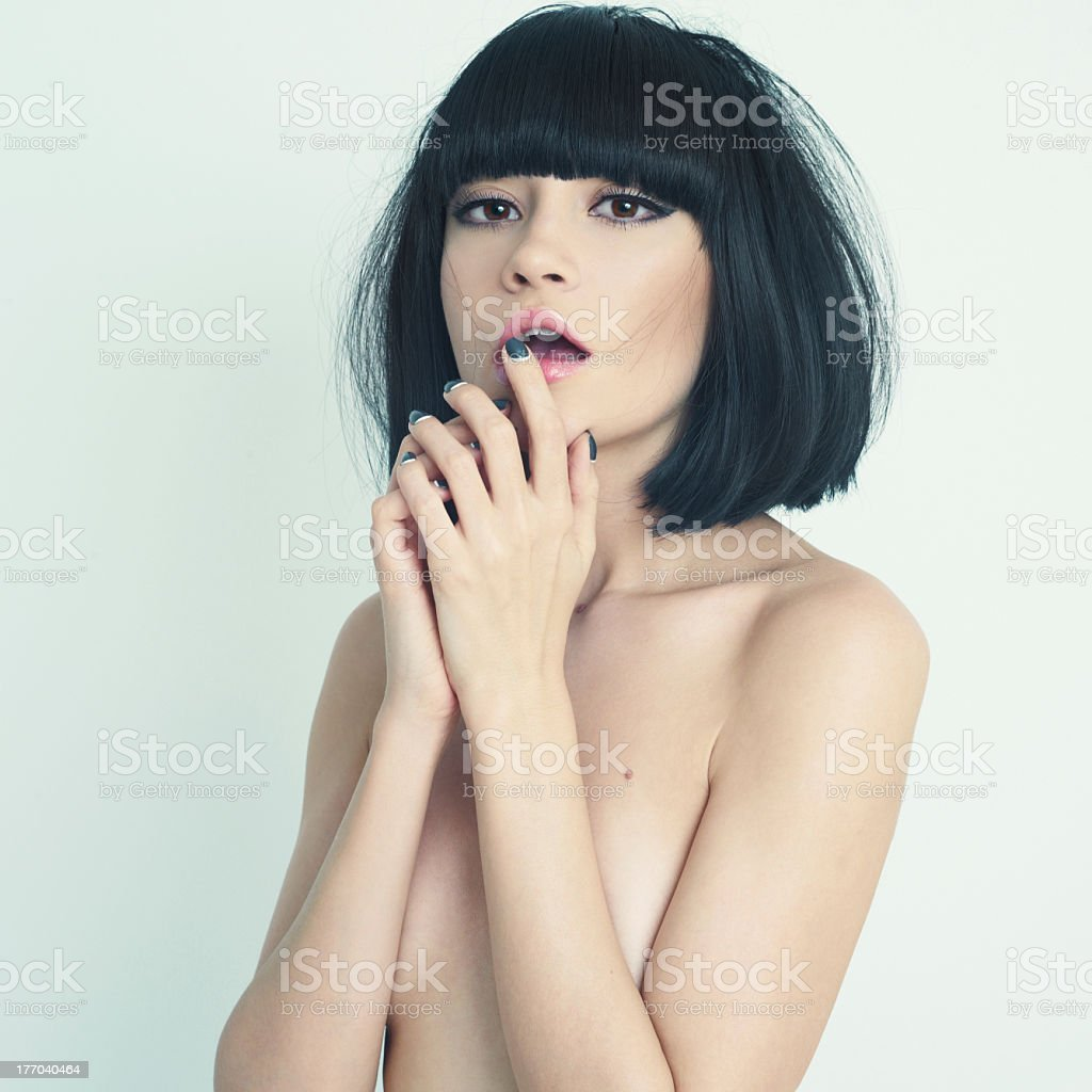 A young woman with short black hair posing without clothes royalty-free stock photo