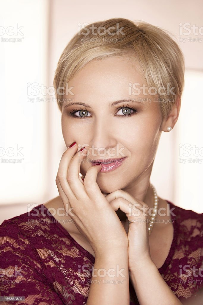 Young  woman with short blond hair stock photo