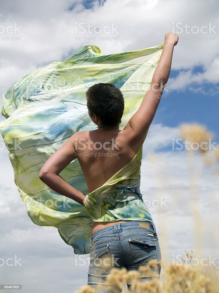 Young woman with silk shawl on a summer day royalty-free stock photo