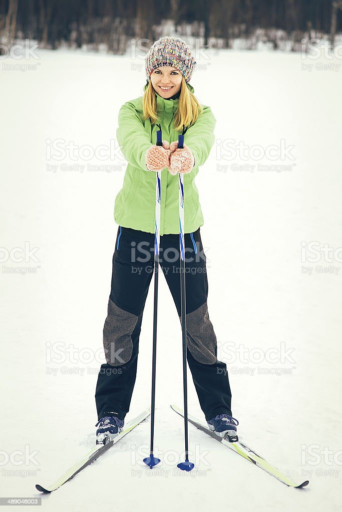 Young Woman with ski happy smiling face winter time stock photo
