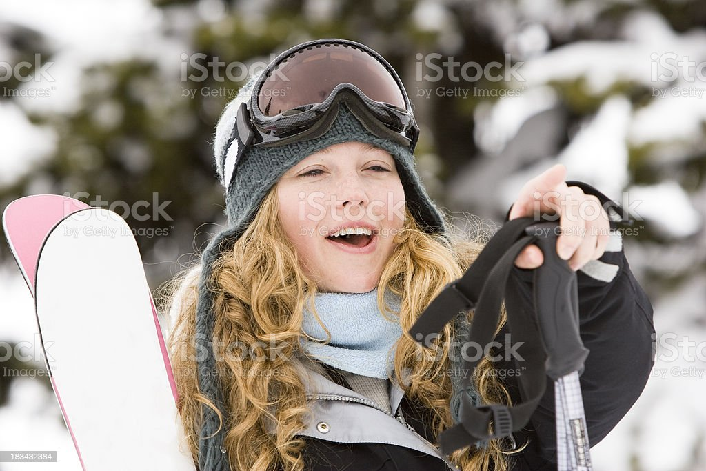 young woman with skis. royalty-free stock photo