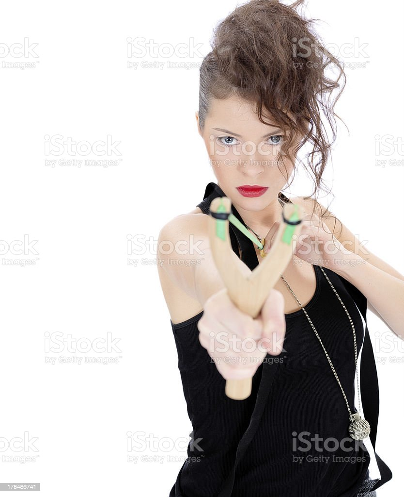 Young woman with slingshot stock photo