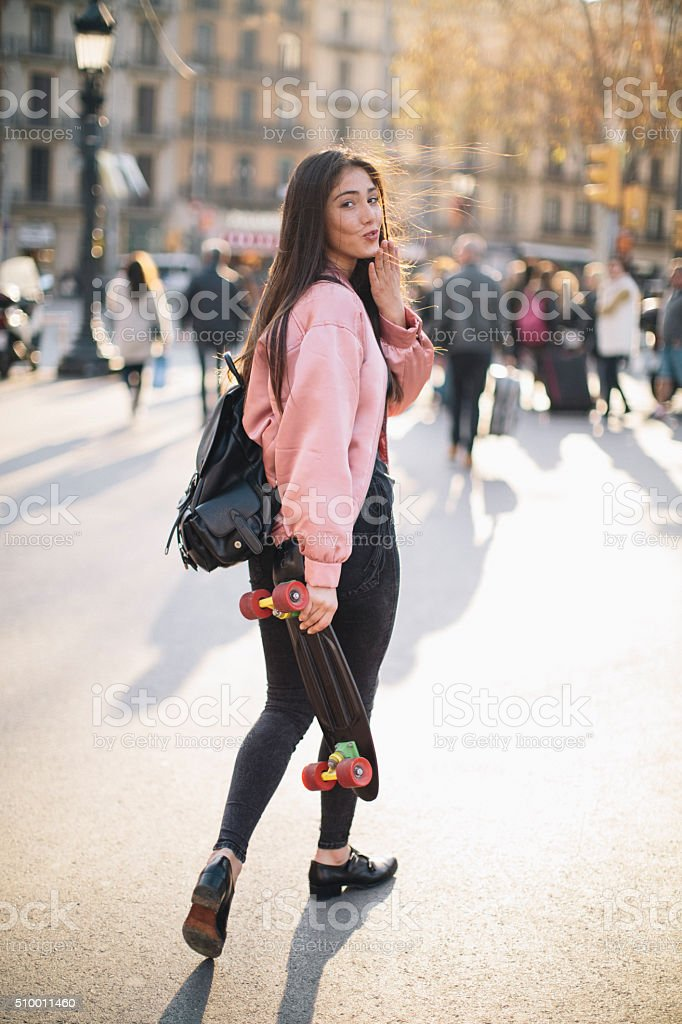 Young woman with smart phone in Barcelona, technology. stock photo