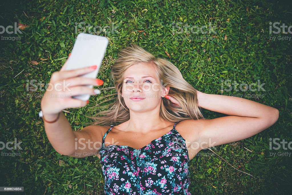 young woman with smart phone in summer stock photo