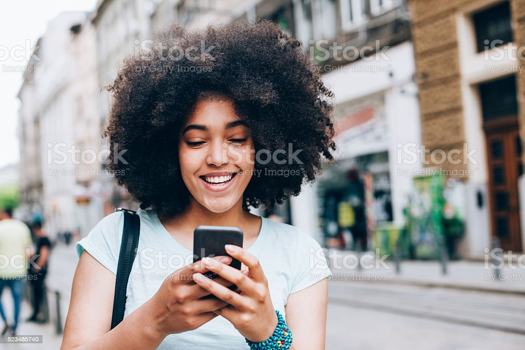 Young woman with smart phone stock photo