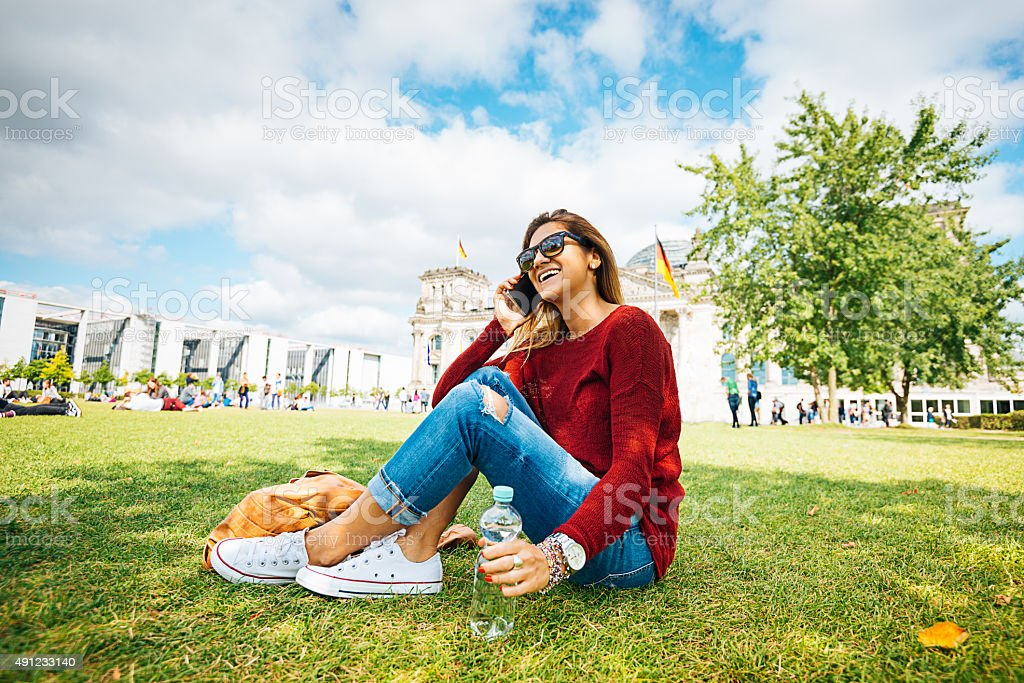 Young woman with smartphone near Bundestag in Berlin in summer stock photo