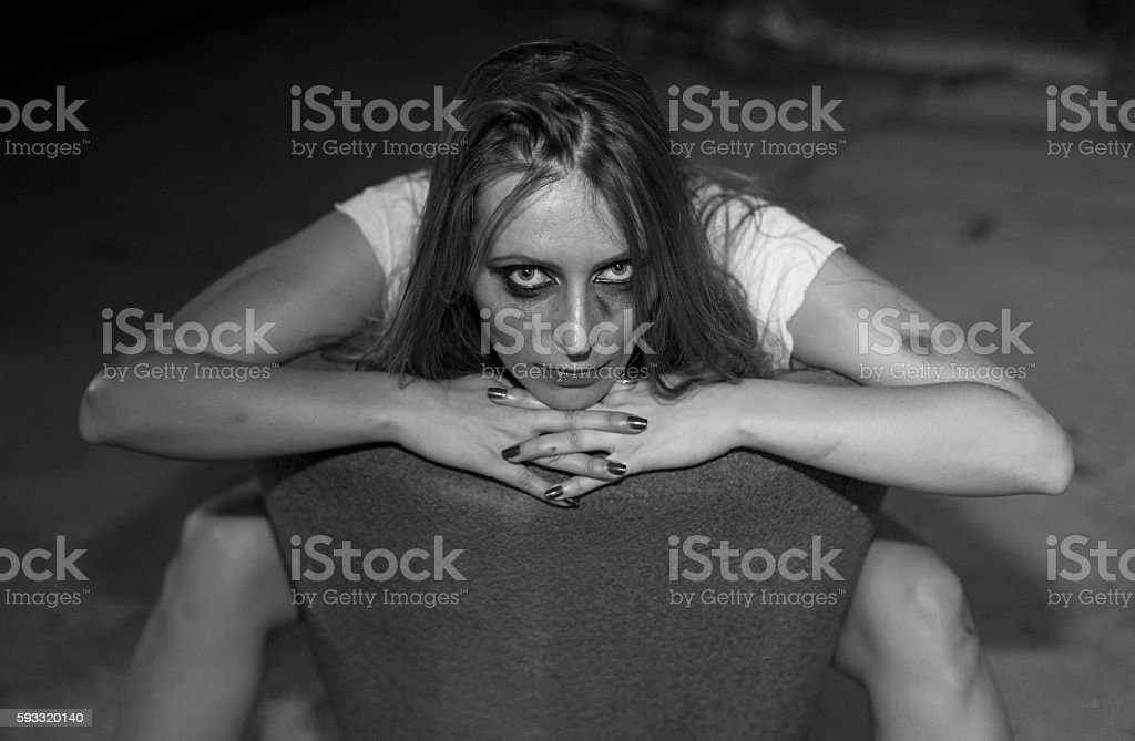 young woman with smeared mascara stock photo